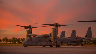 MV-22 Ospreys and KC-130J Hercules are parked during Marine Rotational Force — Darwin trans-Pacific flight, Cassidy International Airport, Kiribati, September 2019