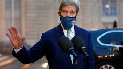 US Special Presidential Envoy for Climate John Kerry speaks to the press following his meeting with French President Emmanuel Macron